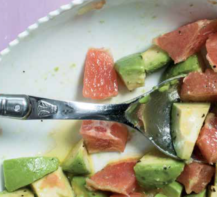 Bowl of avocado salad with spoon